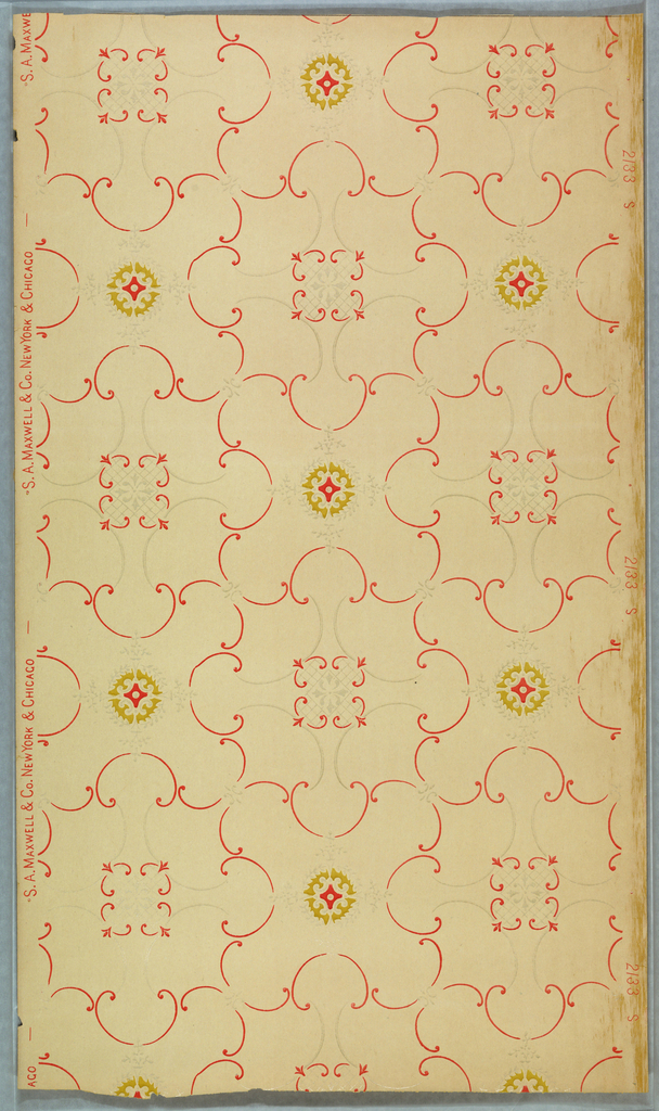 Two alternating motifs: one more round medallion and one more square medallion, all conected by red and gray scrolls.