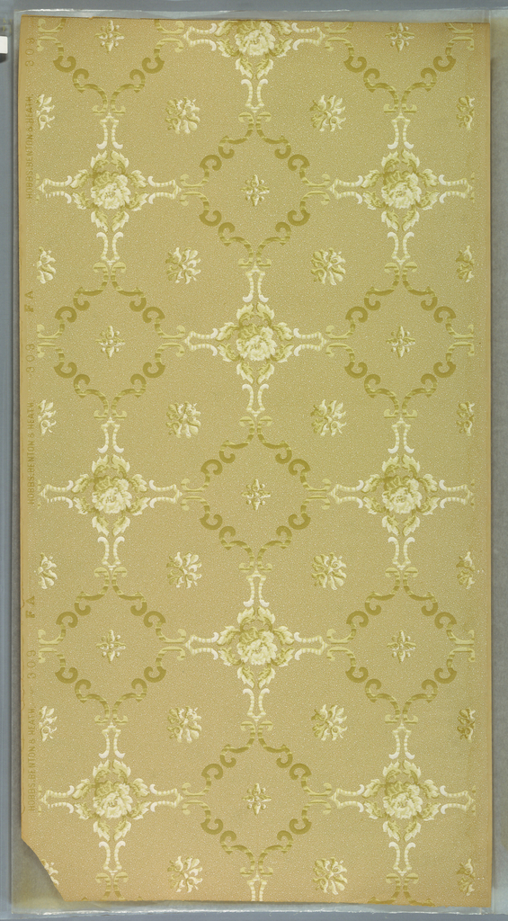 Diagonal squares and rectangles made up of scrolls with fleurons and roses. Background has dots and vermiculation. Ground is beige. Printed in light greens, white, tan. Bottom corner is ripped off.  Printed in selvedge: HOBBS. BENTON & HEATH Co.