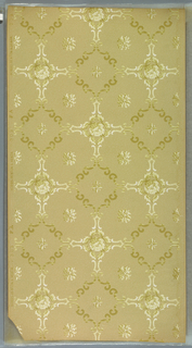 Diagonal squares and rectangles made up of scrolls with fleurons and roses. Background has dots and vermiculation. Ground is beige. Printed in light greens, white, tan. Bottom corner is ripped off. 