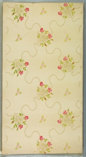 """Pink floral bouquets with bows connected by rope-like ribbon between which is a small pink floral motif. Cream ground. Printed in pinks, greens, golden yellow and white liquid mica. Printed in selvedge: """"C&W"""" pattern number """"268"""""""