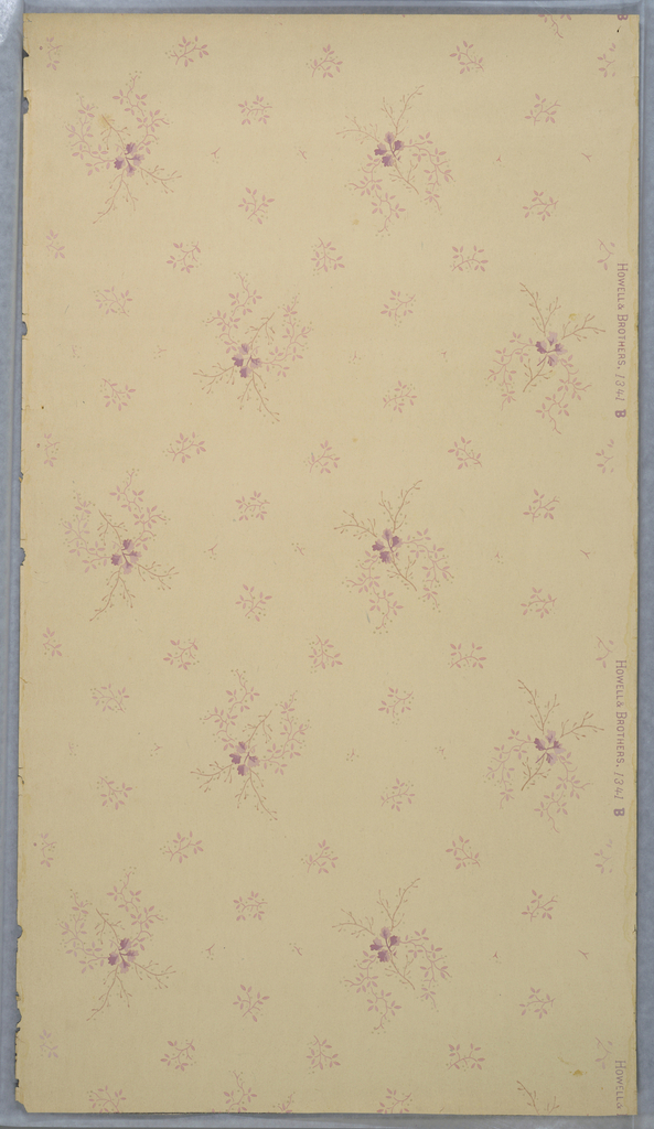 Sprigs of pink flowers surrounded by smaller pink sprigs, printed on white ground.