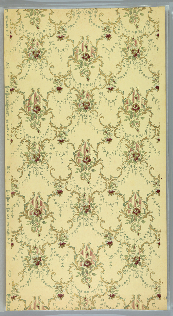 Foliate medallions having a striped fill, each containing a rose and rose bud, connected to adjoining medallions by foliate scrolls and bellflower swags. Printed in green, metallic gold and brown on light yellow or tan ground.