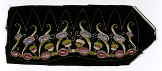 Panel embroidered to shape for a hat. Black velvet with floral chenille embroidery in shades of mauve, pink, green and lavender, with metallic couched thread accents and clear plastic gems. Early 1930s.