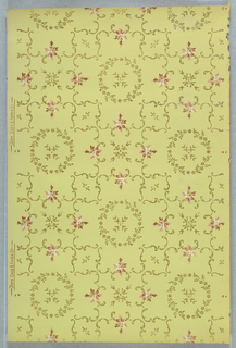 Floral wreaths with bellflower centers within lattice or treelis composed of scrolls. Printed on a chartreuse ground.
