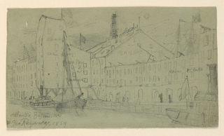 Horizontal rectangle. View looking toward the dock, with warehouses. Two boats at left, and one at extremes right, partially seen.