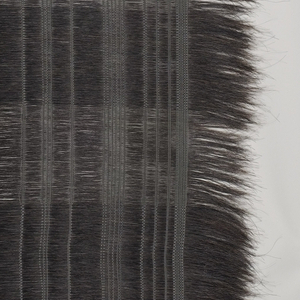 Black horse hairs used end to end as the weft, with several inches left unwoven at each side. The warp is white viscose used in irregular vertical bands. The horsehair is used more or less densely to create wide horizontal bands alternating between sheer and opaque.
