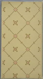 "Lattice pattern with square joints, fleur-de-lis, beading, and flower insets. Background of dotted diamond grid in white mica. Beige ground. Printed in tan, gold mica, pink, white mica.  Printed in selvedge: ""S. A. Maxwell & Co. 2455"" ""VB(?)"""