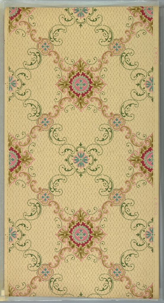 """Two overlapping trelisses, one of green beaded scrolls, fleurs-de-lis and a blue and pink flower center; the other gold scrolls with alternating small and large blue and pink medallions. Background has lines of dots and squiggles. Beige ground. Printed in pinks, blue, green and yellow-browns. Printed in selvedge: """"Y.W.P. Co."""""""