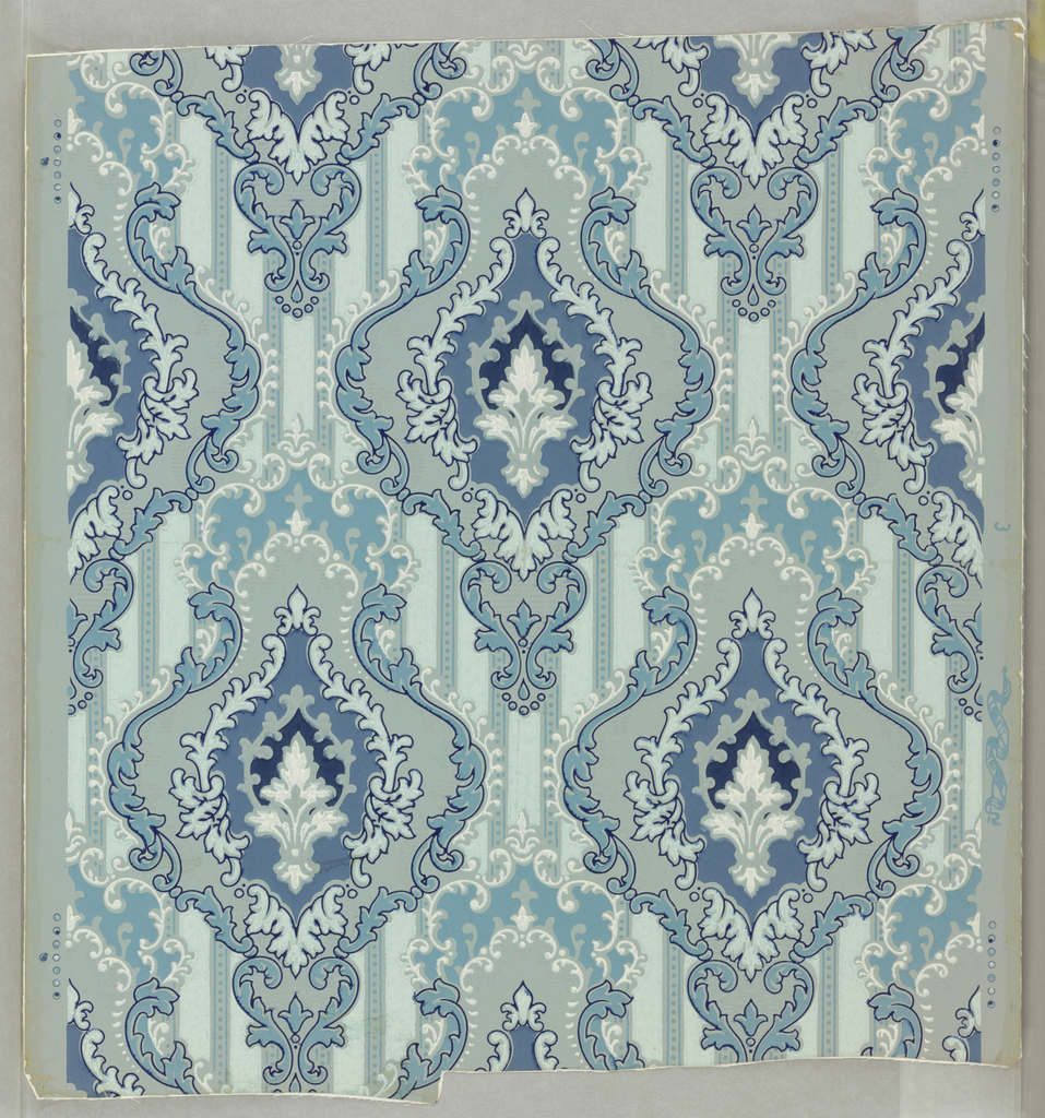 Scrolled multiple cartouches on vertically striped background; pale aqua to dark blue, with white. Drop repeat, straight match.