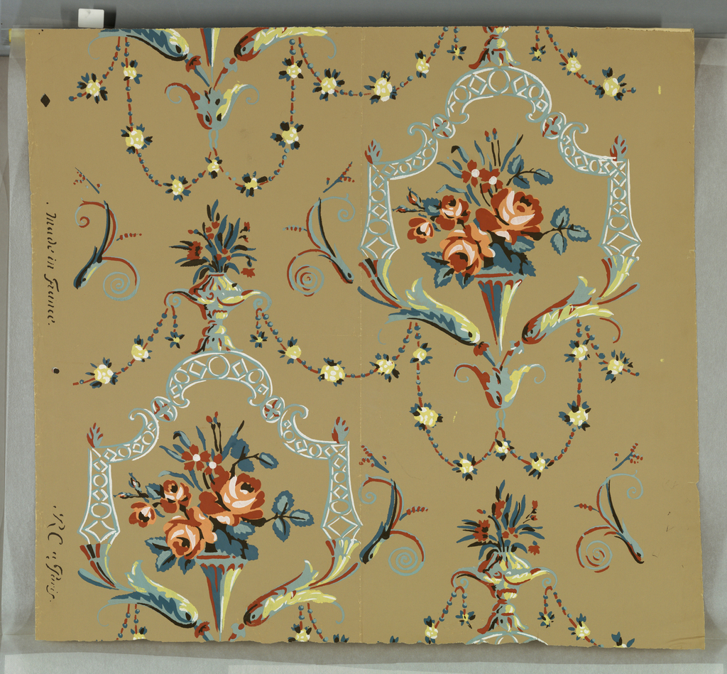 """Vases of roses framed by scrolled foliage and trellis. Terra cotta, yellow, blue and white on tan ground. On margin: """"Made in France, R C a Paris""""."""