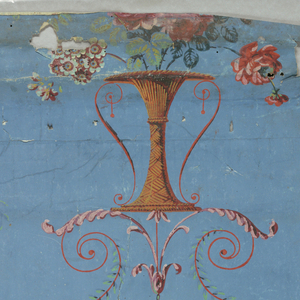 Arabesque on blue ground, features basket with flowers and peacock feather surrounded by figure eight. Full repeat visible.