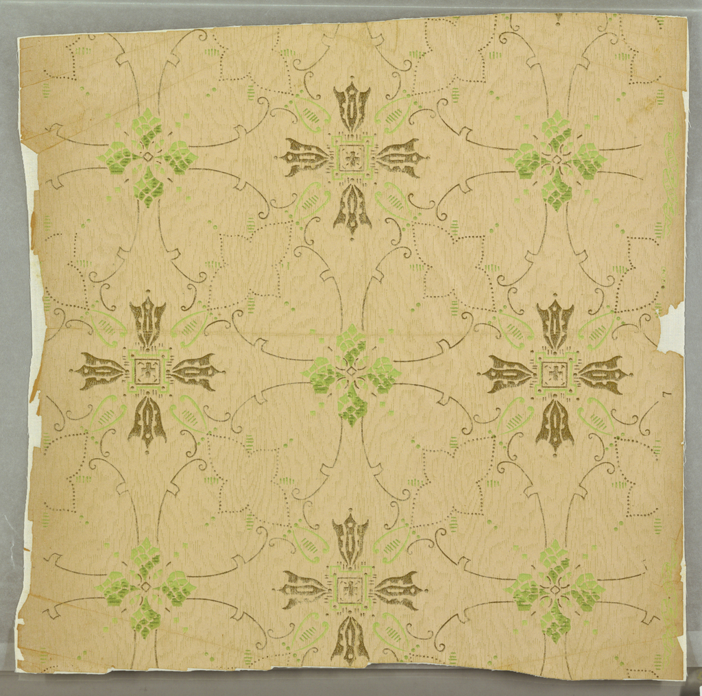 Quatrefoil motifs in green and gold, with connecting thin scrolls on woodgrain imitation on uncoated paper. Drop match, drop repeat.