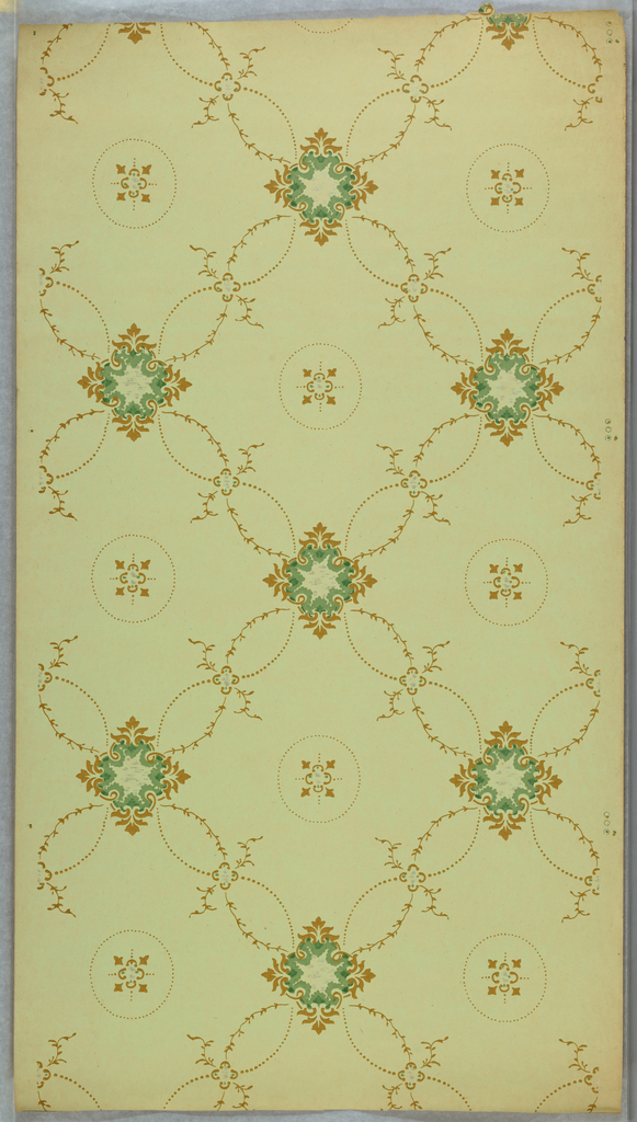Trellis pattern with foliate scroll and dotted lines, square floral motifs at intersections, with a circular motif filling the void. Printed on a light green ground.