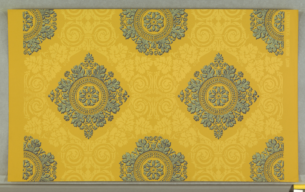 "On mustard yellow ground, lighter yellow acanthus, grape leaves symmetrically surrounding two-tone blue foliate medallions. Printed in margin: ""MUIR'S MEDALLION SCALAMANDRE'S ___"""