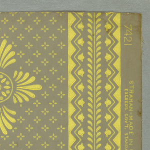 """Striped design of Empire feeling. Motif of wide stripe composed of four anthemions at right angles arranged around a circle and in a drop repeat. Pussy pads geometrically arranged over background. Narrow stripe has a tiny leaf motif either side of center line. Edges of stripe are zigzags with a small bluebell between. Original was found in the John Carver house in Marshfield, Massachusetts, who was the first Governor of Plymouth. Printed on margin: """"Strahan. Made in U.S.A."""" Printed in pale gold on gray field."""