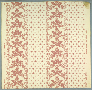 """Reproduction by Nancy McClelland of an old paper from the Glebe House, Southbury, Connecticut. Simulates stencil work. Reproduced for the """"Blue Bedroom"""" at the home of George Washington, Mount Vernon, Virginia. The design is composed of two equal width stripes. One is covered with tiny squares and dots aranged in diagonal rows. The other stripe is a small drop repeat of pineapple and foliage. The stripes are edged with a lace-like border. Printed in selvedge: """"Mount Vernon, Glebe House, Southbury, CT."""" Printed in pink on white ground."""