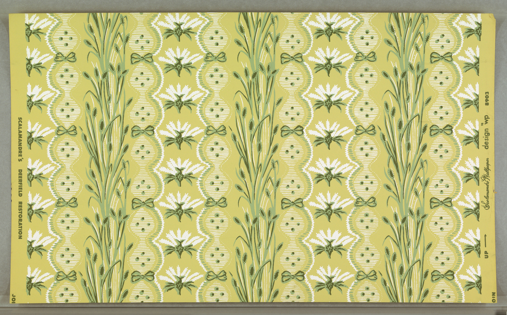 """On yellow ground, pattern in two shades of green and white. Elements arranged in vertical stripings of bullrushes; flowers, bows and scalloped edged bandings. Printed in margin: """"Scalamandre Wallpaper design No. 8903/ Scalamandre's Deerfield Restoration."""