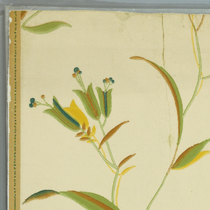 Against a cream-colored ground are printed thin serpentine stems from which grow simplified foliage and blossoms printed in muted green, brown, yellow and blue. Half-drop repeat.