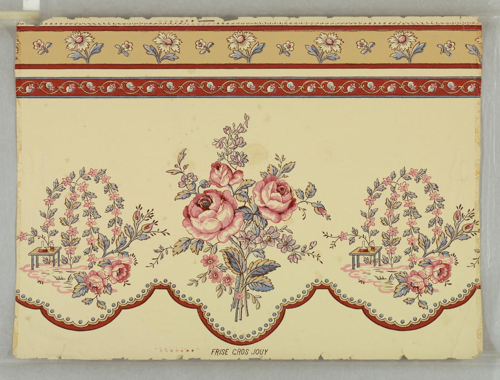 "A scalloped border in which a bouquet of roses alternates with a still life of roses, drooping flower vines, and a table holding decanter and glass. Red, pink, and lavender on cream-colored ground. Above, a border of buds on red ground and a border of daisies on beige ground. In style of late 18th century ""toile de Jouy"". On margin: ""Frise Gros Jouy""."