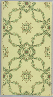 Flitter ceiling paper. Foliate trellis or diaper pattern with large squarish medallion in center containing floral motif. Elements outlined in gold mica flakes. Printed on light tan ground.