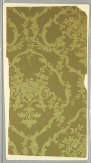 Diaper pattern, yellow-green vining floral and scrolls printed on olive-green ground.