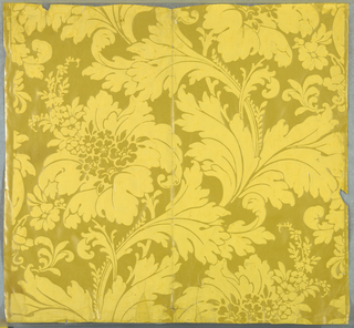 Design of large flowers with scrolling leaves and stems in dull yellow on bright yellow ground. Art nouveau style.