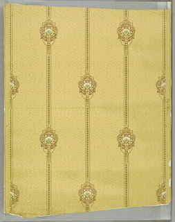 Small green floral motifs surrounded by gold scrolls and connected by vertical gold bands; on yellow ground imitating textile weave. Drop repeat,straight match.