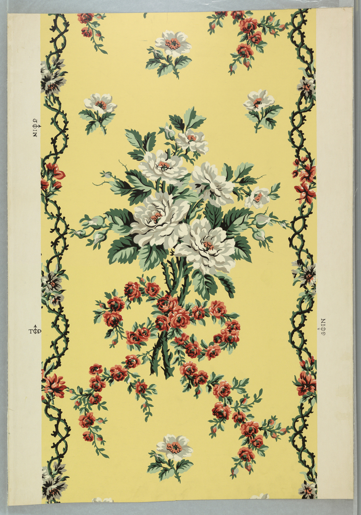 A reproduction of a French wallpaper by Zuber. A large bouquet of white roses held together with a chain of small red roses tied in a bow with flowing streamers. Small sprigs with a single white rose are scattered about top and bottom of drop repeat. On both margins is a vertical redorte of intertwined rose stems with blossoms at point of intersection. In the style of first quarter of 20th century. Printed in white, gray, red, green, orange and black on gold field.