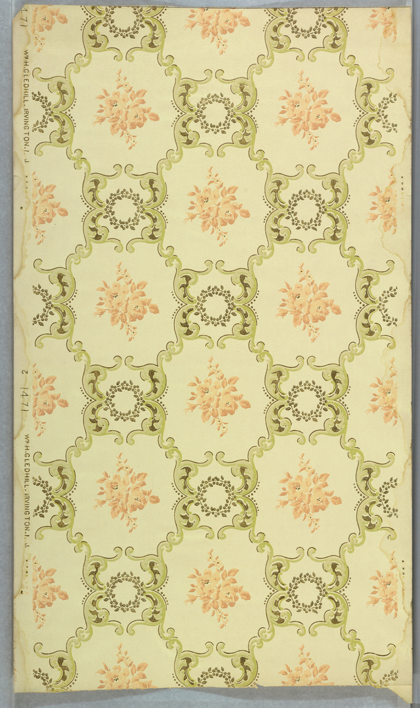 On light gray, scroll light green-gray treillage with gold highlights and wreaths containing pink floral clusters.