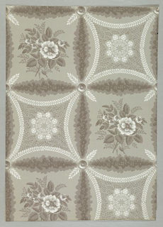Leafy vines forming squares enclose alternately a bunch of roses and a regular geometrical figure with four concave sides outlined with leafy stems. The latter enclosed lace-like rosette of leaf sprigs and florets. The arcs of the alternating four-sided figures connect to make large circles. Printed in gray and white on pale gray ground.