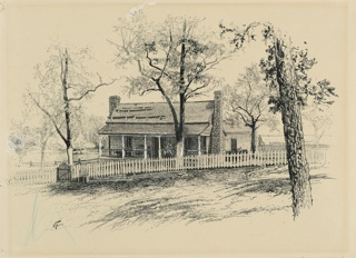 View of a Dutch farmhouse with a white picket fence