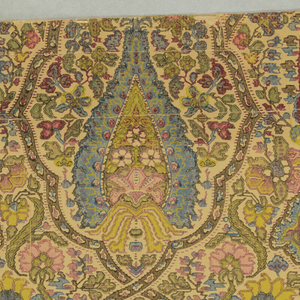 Stylized floral motifs set within an ogival framework. Resembles paisley and has a slightly Moorish look.