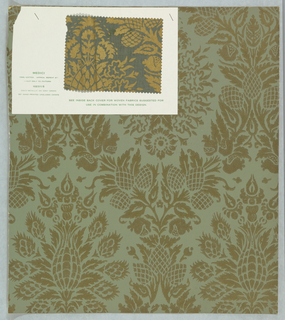 Diaper pattern, consisting of vining floral with pineapple-like fruit, printed in gold metallic on gray-green ground. Fabric sample attached.