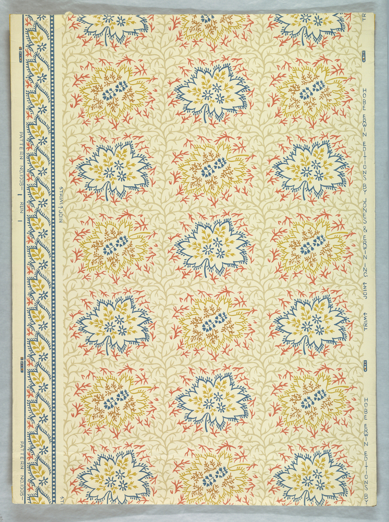 Stylized leaf motifs, printed in rows, alternating between blue outlines and yellow outlines. The background is covered by a leaf-vein design. Printed in blue, yellow red, brown and gray on a white ground. Pattern #1008, produced by Hobe Erwin Editions.