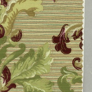 Large lily flanked by fleur-de-lys; leaves and scrolls. Greens and dark red on strie ground, over-printed with pale green at bottom of design.