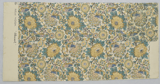 Wall paper and matching fabric. Design of curving stems with perching birds among flowers and leaves. Printed in pink, blue, brown, green and black on tan ground.