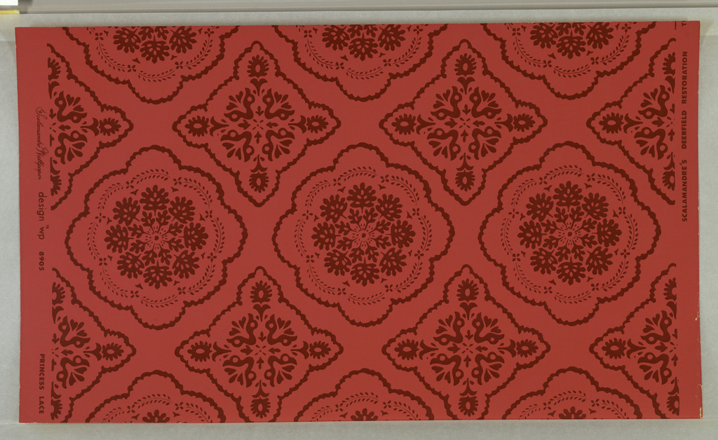 On bright pink ground, pattern in maroon of lace doilies, alternating between square and round. Printed in red.