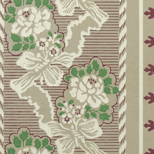 A reproduction of a paper found in an old New England house. The design is composed of two different alternating stripes. The wider one has small sprays of roses bowknotted together by a broad ribbon streamer. The narrow stripe is a vertical reeded molding. Silver label is pasted on surface. Printed in red, green and white on gray field.