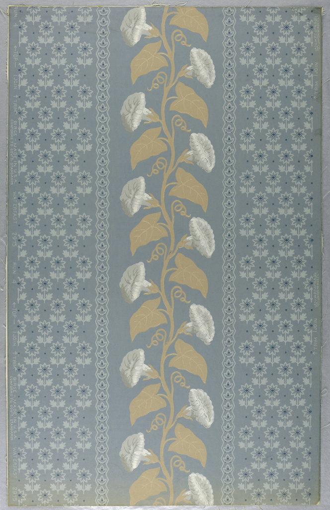 "A vertical floral stripe of flowering morning glories and leaves is between wide bands with an all-over design of small upright stylized flowers in tones of blue. This band is edged by narrow borders of similar design. Reproduced from old paper formerly on the walls of the drawing room in the Jumel Mansion in New York, NY. Original was printed in France 1800-1810. Printed on reverse side: Trademark of Birge Co. ""Side wall 2975 D, water- fast, light resisting, packed 50 rolls to bundle"". Printed in ivory, beige, pale and dark blue on medium blue field. Not original colors."