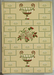 """a) On beige ground, rectangles arranged like building blocks or brick, each with a central motif with floral center. """"Block"""" pattern interrupted by reserves with alternating two-handled epergne and bunch of grapes. b) duplicate, on pale green ground, with shades of green, red and white. Printed in selvedge""""T S Co. (thistle) 9909"""""""
