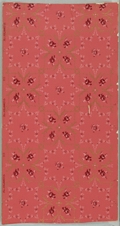 Bold leafy scrolls with small pink roses alternate in checkered fashion with delicate ropes of small flowers forming eight-pointed star centered with small flower and bud. Printed on pink ground.