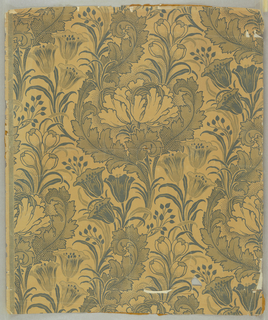 Design shows William Morris influence. Peonies, crocuses, tulips, acanthus leaves, done in monochrome shades; light and dark olive green on pale mustard ground.