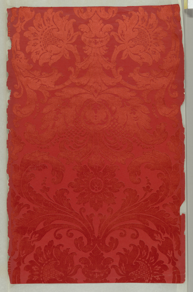 Bisymmetrical heavy flower and leaf design. Straight across match. Large scale. Printed in red flock and shiny red ground.