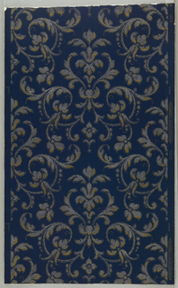 Gold and silver foliate arabesque on dark blue ground. Straight across match.