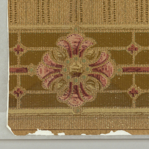 Pink and green fan-shaped motif, surrounded by green petals, set in shaded olive rectangle. Border of pink and red flower in olive band. Tracery work,on beige ground imitating textile.