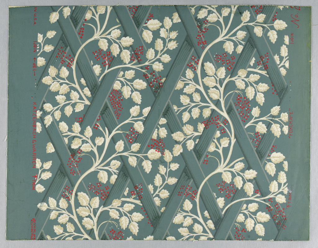 Design of trellis with grape vine. This is an approved Colonial Williamsburg, Virginia, reproduction. The original paper was found in an old Williamsburg house and also in Jefferson's home at Monticello. This is not the original color. Printed in beige and red on Williamsburg blue field.