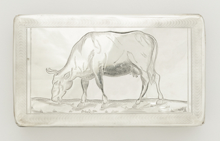 "Rectangular flat box with hinged cover. Underside engraved with parallel lines forming stripes. Outer edges with double stripe of engraved lines. Cover with engine-turned border surrounding engraved image of cow eating grass. Interior of cover inscribed: ""Verneerd door het Stedelyk bestuur van Monnickendam, van Jan de Wit, voor de meest ter verkoop aangebragte Runderen op de Jaarmarkt den 26 April 1848."""