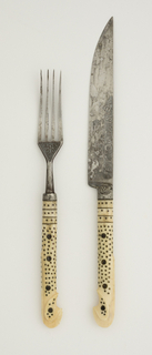 Fork has four curved tines. Angular shoulders, engraved decoration on front and back of join, plain neck. Ivory handle oval in section, flaring towards the end. Handle inlaid with small brass dots and three horizontal brass bands.