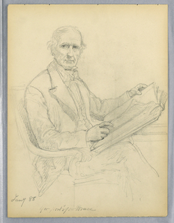 Man seated in an armchair, holding an open book in both hands. It rests on his legs and the table, at right. He is turned to the right, but faces frontally.