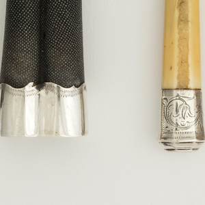 Shagreen case for two implements, silver cap and top mount with curved borders.